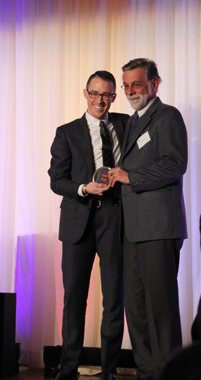 Executive Director, Robert Restuccia accepts MassEquality's 2014 Community Icon Award from Kellan Baker of the Center for American Progress.